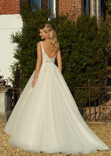 Carol - Pretty ballgown with V-neckline, lace bodice, scoop back and handed beaded waist detail. Full tulle skirt, finished with a subtle layer of sparkle