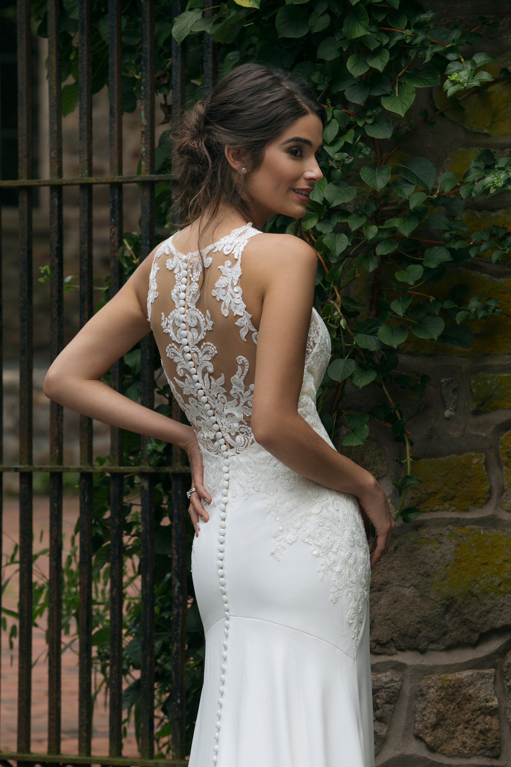 44048 - Crepe fit and flare gown, lined in jersey for effortless movement, lace appliques adorn bodice